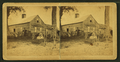 Family members posing against their block house with a stone fence, from Robert N. Dennis collection of stereoscopic views.png