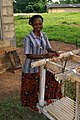 Female-working-extracting-moisture-from-cassava-roots.jpg