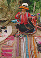 Female from Peru using drop spindle.jpg