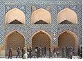 Female students walk by the wall of Amir Chakhmaq Complex.jpg