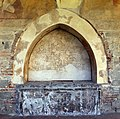 Figline valdarno, san francesco, chiostro, sinopia di affreschi di pierfrancesco fiorentino, 1494, e tomba ad arcosolio.jpg
