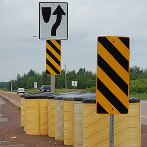 Traffic barrier - Sand filled barrels in Canada used as impact attenuators.