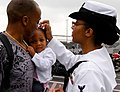 Flickr - Official U.S. Navy Imagery - A Sailor is greeted by her family during a homecoming celebration..jpg