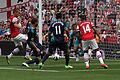Flickr - Ronnie Macdonald - Lukas Podolski ^ Theo Walcott attack.jpg