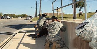 2009 Fort Hood shooting - Bystanders take cover as shots ring out from the Soldier Readiness Processing Center.