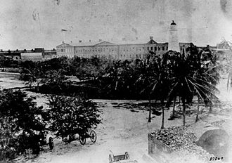 Garden Key Light - The old brick tower standing beside Fort Jefferson before the tower was torn down in 1877.