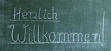 German welcome notice on a blackboard.jpg