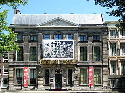 The Escher Museum in The Hague. The poster shows a detail from Day and Night, 1938 Gevel Escher in Het Paleis 300 dpi.jpg