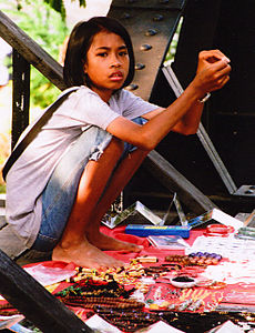 Girl in Thailand who sells stuff on the bridge on the river kwai.jpg