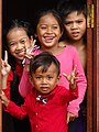 Group of Kids in Doorway - Kampong Cham - Cambodia (48328951402).jpg