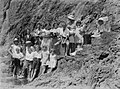 Group portrait of many people along cliff side (AM 87714-1).jpg