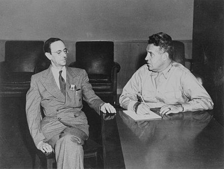 Groves confers with James Chadwick, the head of the British Mission. Groves and Chadwick 830308.jpg