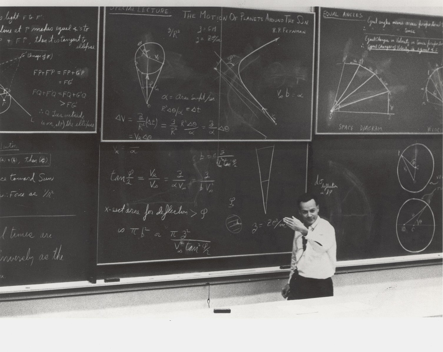 Man at a college-lecture-hall-sized blackboard