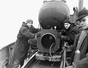 Minelayer - Canadian sailors with a mine aboard the minelayer HMCS ''Sankaty'' off Halifax, Nova Scotia in World War II
