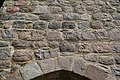 Handwerkerzeichen über Portal der Sternhagener Kirche.jpg