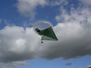 Kytoon aircraft which obtains some of its lift dynamically as a heavier-than-air kite and the rest aerostatically as a lighter-than-air balloon