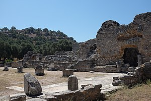 Iasos - The hill with the acropolis, the bouleuterion (center) and a Hellenistic tower (right) near the agora of Iasos.