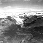 Herbert Glacier, terminus of valley glacier, and hanging glaciers on the surrounding mountainsides, September 18, 1972 (GLACIERS 6356).jpg