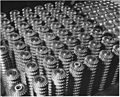 Hundreds of these precision cut gears roll off specially designed gear-cutters daily in the Bors plant of a large... - NARA - 196208.jpg