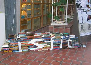"International Student Festival in Trondheim - A book pile illustrating the theme of the festival of 2005, ""Education, why?""."