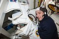 ISS-38 Michael Hopkins spacesuit tests and repairs in the Quest airlock.jpg