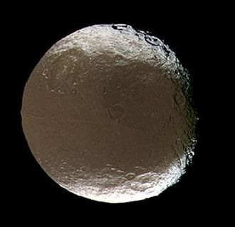 Iapetus (moon) - View of Cassini Regio. Large craters visible include Falsaron (upper left), Turgis (above and right of center) and Ganelon (lower right)