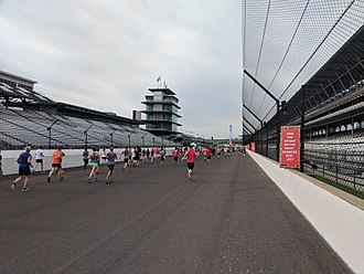 Indianapolis Motor Speedway - Runners in the OneAmerica 500 Festival Mini-Marathon reaching the Indianapolis Motor Speedway in 2018