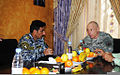 Iraqi Maj. Gen. Ali Ibrahim Daboon Al Maksusi, left, commander of the 1st Iraqi Federal Police Division, converses with Lt. Gen. Frank G. Helmick during his visit to Joint Security Station Loyalty, Iraq, March 110323-A-VP478-002.jpg
