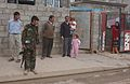 Iraqi police, U.S. Soldiers patrol neighborhood in Mosul DVIDS40274.jpg