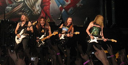 Iron Maiden is a six-part band with a lead vocalist, three guitarists, a bassist, and drummer lineup. (Not shown in this image are Bruce Dickinson and Nicko McBrain.) Iron Maiden in performance.jpg