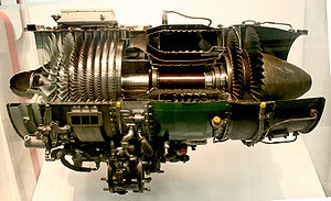 Gas turbine - typical axial-flow gas turbine turbojet, the J85, sectioned for display. Flow is left to right, multistage compressor on left, combustion chambers center, two-stage turbine on right