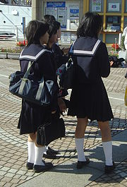 Japanese high school students wearing the sailor fuku