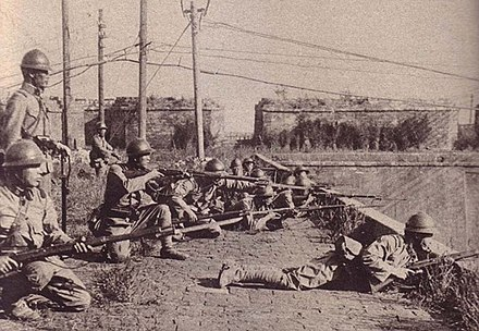 Japanese soldiers of 29th Regiment on the Mukden West Gate Japanese soldiers taking an offensive posture on the Mukden Little West Gate.jpg