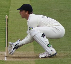 English: Jos Buttler keeping wicket during a C...
