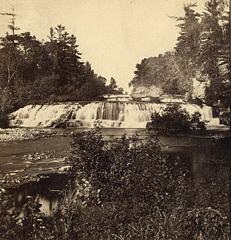 """Kinnickinnic River (St. Croix River tributary) - The historic Junction Falls of the Kinnickinnic River in River Falls, Wisconsin prior to the construction of any dam in the Kinnickinnic River.  This photograph was originally taken by John Carbutt between 1864 - 1865 and published as a stereoview in a set of scenery pictures of """"The Upper Mississippi, Minnesota and the Vicinity""""."""