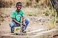 Kid enjoying with clean water.jpg