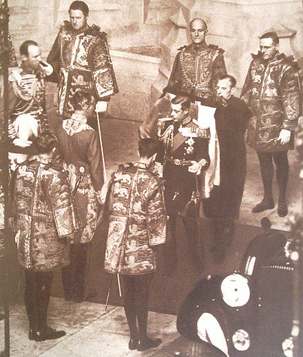 Edward VIII surrounded by heralds of the College of Arms prior to his only State Opening of Parliament, 3 November 1936 King Edward VIII opening Parliament.jpg