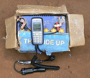 Communications in Uganda - A cell phone being charged from a car battery in Kiwanja, Uganda.