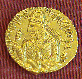 "Huvishka - Coin of Huvishka. Legend in Kushan language (with the Kushan letter Ϸ ""sh""):  (""Shaonanoshao Ooishki Koshano""): ""King of kings, Huvishka the Kushan""."