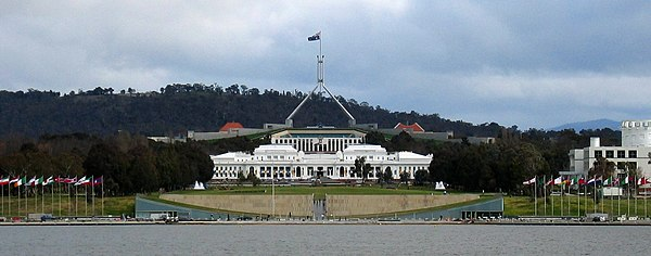 Two of Canberra's best-known landmarks, Parliament House and Old Parliament House (foreground). Commonwealth Place runs alongside the lake and includes the International Flag Display. Questacon is on the right. Lake-ParlHouse.JPG