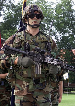 Land Warrior - A U.S. Army soldier displays the 21st Century, Land Warrior, Integrated Fighting System at Fort McPherson, Georgia in June 2001. The system consists of a global positioning system, within a computer/radio subsystem.