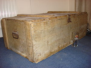 A large wooden box, possibly Victorian, thrown...