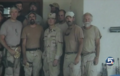 Layne Morris in a photo a fellow GI took of his unit, in Afghanistan, in 2002 -a.png