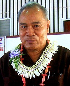 Man wearing a white lei