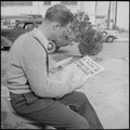 Los Angeles, California. Lockheed Employment. Cause and Effect. This young man reading the war news holds an... - NARA - 532213.tif