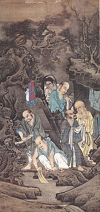 A portrait oriented painting depicting six figures, five elderly, balding men, and one younger attendant, washing clothing on the edge of a river. The background is painted in dark colors while the figures are painted in white and light colors.