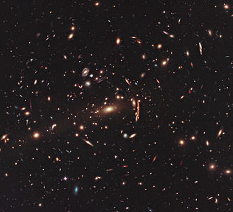 Gravitational lens - This image from the NASA/ESA Hubble Space Telescope shows the galaxy cluster MACS J1206.