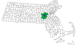 MetroWest Regional Transit Authority - Map of the MetroWest Regional Transit Authority (MWRTA) service area in green with the central hub town of Framingham in blue.