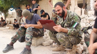 Sham Legion - Major Yasser Abdul Rahim, field commander of the Sham Legion and commander of Fatah Halab during the Battle of Aleppo, coordinate an attack on YPG positions in Aleppo, 2 October 2015.