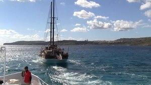 File:Malta - Comino - Blue Lagoon Harbour + Gozo (Keppel) 01 (0) ies.webm